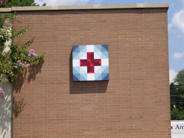 image of quilt block called Claras Red Cross Of Service